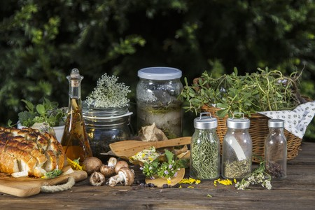 Various wild herbs (fresh, dried and in jars), mushrooms, herb butter and pull apart bread LANG_EVOIMAGES