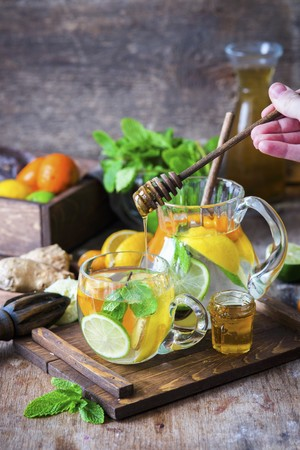 non alcoholic: Detox water with citrus fruits, ginger and honey