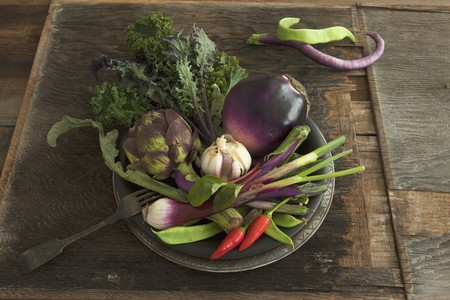 bean family: A bowl of vegetables with aubergines, artichoke, garlic and chillies