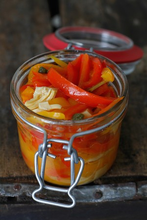 pimiento: Italian Pickled Peppers in a Jar on a rustic wood background LANG_EVOIMAGES