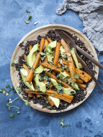 Gluten-free black quinoa salad with avocado and carrot