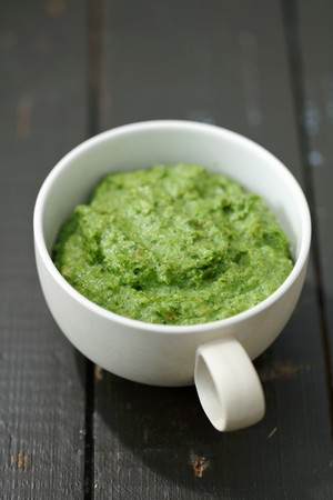Homemade broccoli and spinach pesto in a cup LANG_EVOIMAGES