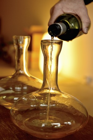 Decanting a white wine in a karaf