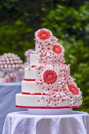 Multi tier summer wedding cake with floral decoration
