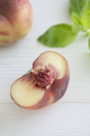 halved  half: Half a peach