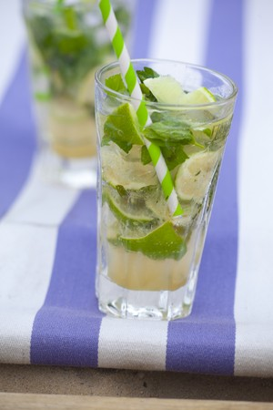 alcohol series: Virgin mojitos with ginger ale, lime and mint in glasses