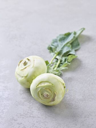 Two kohlrabi with leaves