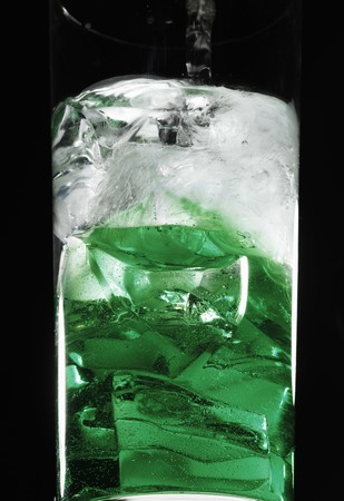 icecubes: Peppermint liqueur poured into a cocktail glass with ice cubes LANG_EVOIMAGES