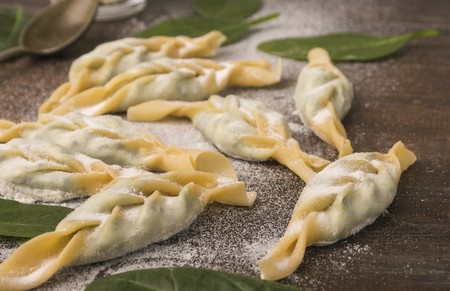Turtei, a braided ravioli made with fresh eggs and semolina filled with ricotta and spinach