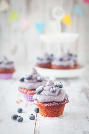 childs birthday party: Red velvet cupcakes with blueberries
