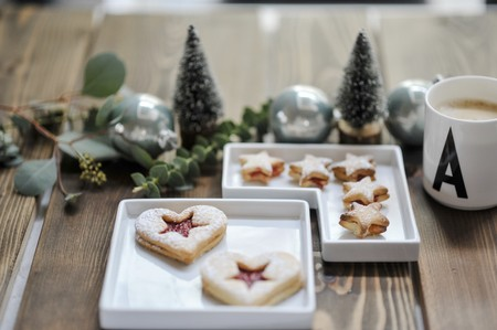 ides: Two pastries in small bowls and a Christmas table decoration