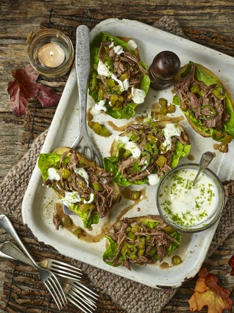 minted: Baked potato skins, filled with spicy minted lamb shoulder and lettuce