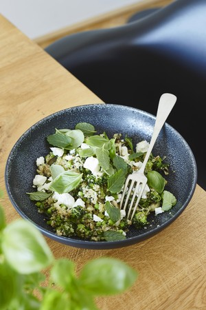 Quinoa salad with broccoli and herbs