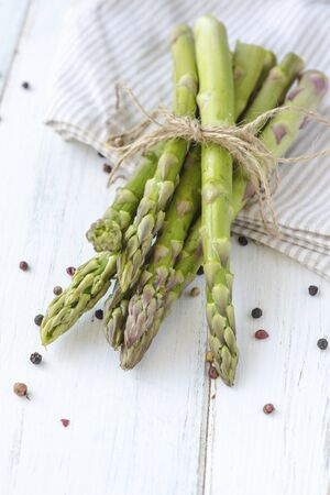 A bunch of green asparagus on a cloth LANG_EVOIMAGES