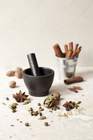 Masala chai spices with a pestle and mortar