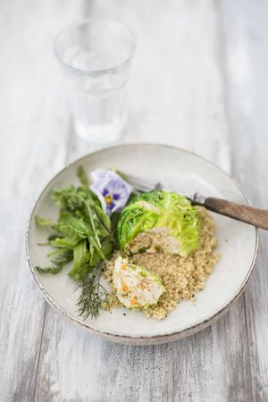 Savoy cabbage balls on a bed of quinoa