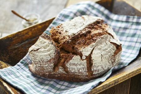 Rustic country bread on a checked napkin