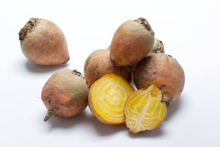 whiteness: Golden beets on a white surface