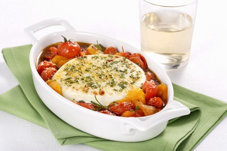 Primosale al forno (oven-baked sheeps cheese with vegetables, Italy)