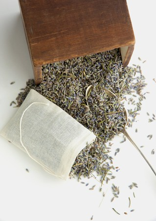 stuffing: Dried lavender flowers being filled into a teabag
