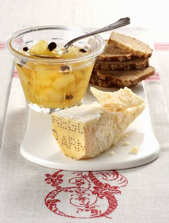 Pear compote with chocolate served with Parmesan cheese and bread LANG_EVOIMAGES