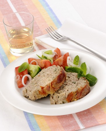 meatloaf: Meat loaf wrapped in bacon with a tomato salad LANG_EVOIMAGES