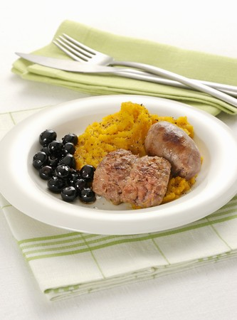 Sausages with mashed pumpkin and black olives