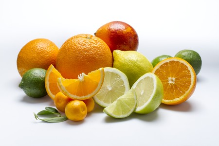 whiteness: An arrangement of citrus fruits on a white surface