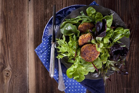 looseleaf: Quinoa fritters on a bed of lettuce LANG_EVOIMAGES