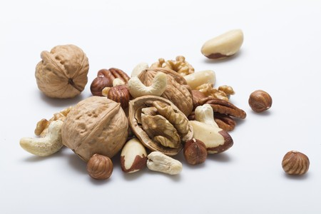 whiteness: Various nuts on a white surface LANG_EVOIMAGES
