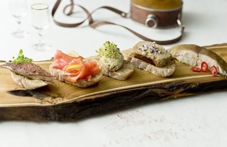 Various crostini with smoked trout, smoked salmon, mackerel pate, eel pate and smoked halibut