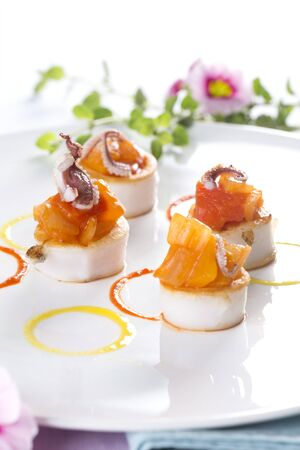 Scallops with salmon and baby octopus LANG_EVOIMAGES