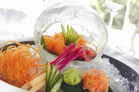 ides: Sashimi on a serving platter and within a decorative ice cube (Japan)