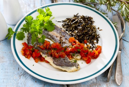Hake fillets with a pepper salsa and wild rice