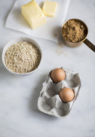 Baking ingredients: butter, oats, eggs and brown sugar