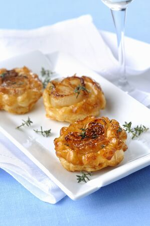 Mini tarte tatins with white onions