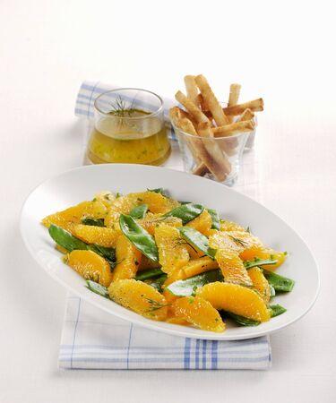 tout: Orange and mange tout salad with breadsticks