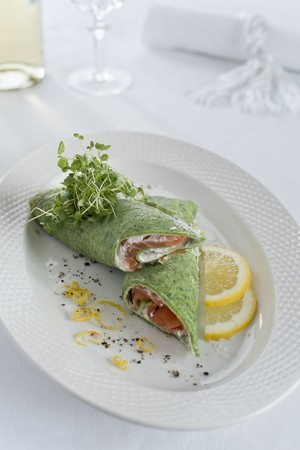 Spinach pancakes with smoked salmon and fresh cheese