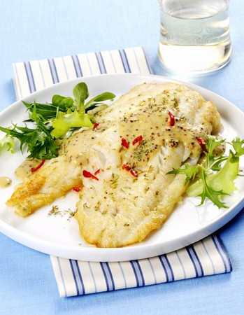 Cod fillet with herbs, chilli and a mustard sauce