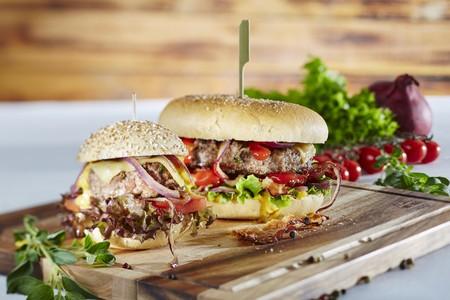 food: A mini hamburger and an XXL hamburger