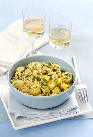 Gnocchi al rag� di mare (gnocchi with seafood ragout, pistachios and sesame seeds, Italy)