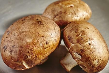 Three fresh brown mushrooms (close up)
