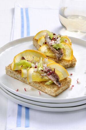 Crostini with anchovies and oranges LANG_EVOIMAGES