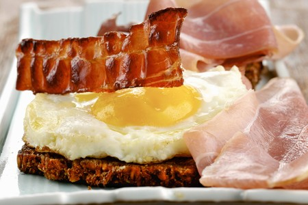 Toast with ham, fried egg and bacon