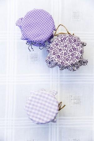 Jam jars with various fabric decorations