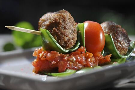 food: Meatballs with tomatoes on sticks
