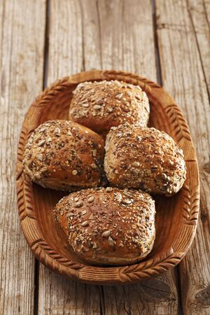 Seeded rolls in a wooden bowl