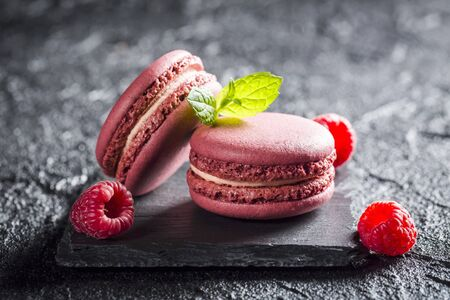 pinky: Raspberry macaroons on a black stone LANG_EVOIMAGES