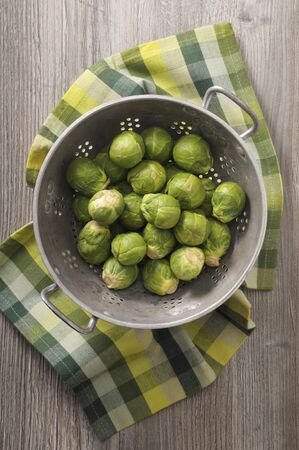 Fresh Brussels sprouts in a colander (seen from above) LANG_EVOIMAGES