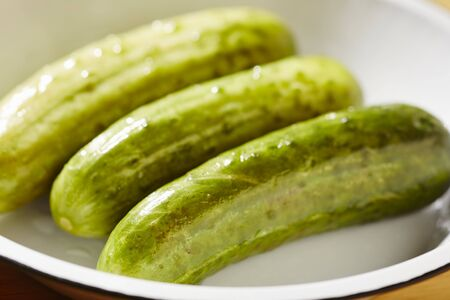 Three semi-pickled cucumbers (a traditional delicacy from New York City)
